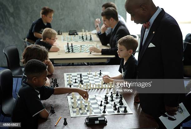 S Senate Chaplain Barry Black and 4th grader Makin Sowell of the local Elsie Whitlow Stokes Community Freedom Public Charter School participate in a...