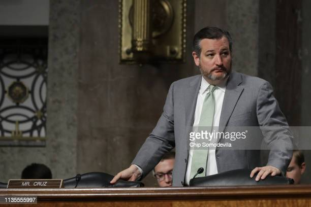 Senate Commerce Science and Transportation Committee member Sen Ted Cruz prepares to leave a hearing in the Dirksen Senate Office Building on Capitol...