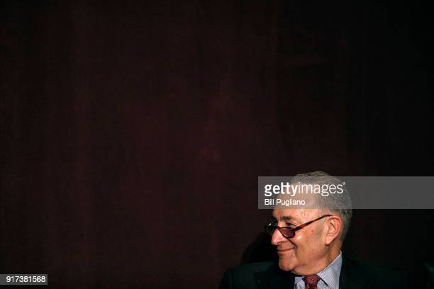 S Senate Democratic Leader Chuck Schumer listens to US Senate Majority Leader Mitch McConnell introduce him at the University of Louisville's...
