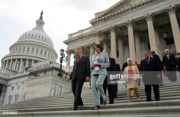 S Senate Democratic Leader Harry Reid and House Democratic Leader Nancy Pelosi followed by Democratic senators and representatives emerge from the...