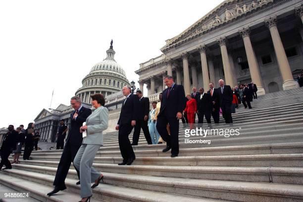 Senate Democratic Leader Harry Reid front left and House Democratic leader Nancy Pelosi front right and House and Senate Democratic senators and...