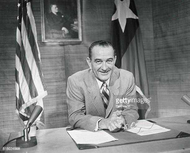 Senate Democratic leader Lyndon Johnson is shown as he addressed a TV-radio audience last night. Behind him are the flags of the U.S. And of Texas....