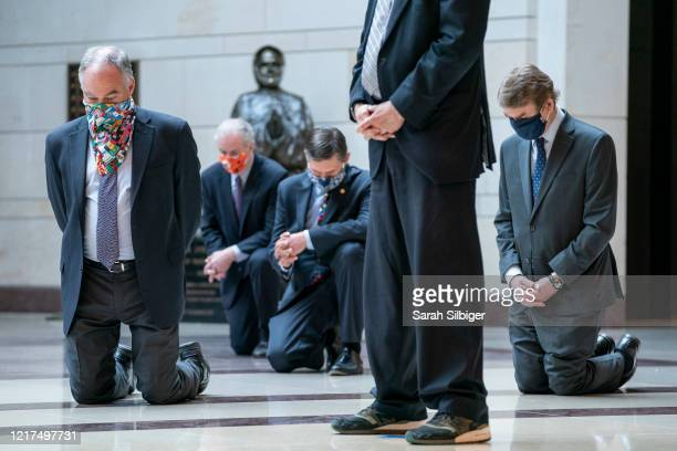 Senate Democrats including Sen Tim Kaine Sen Michael Bennet take a knee as they participate in a moment of silence to honor George Floyd and the...