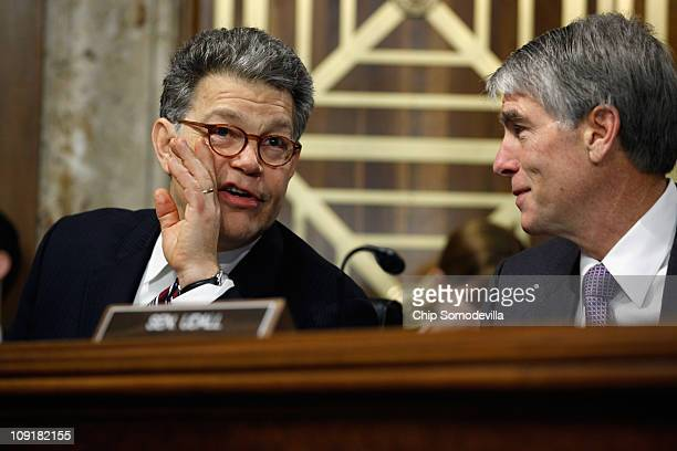 Senate Energy and Natural Resources Committee members Sen. Al Franken and Sen. Mark Udall speak during a committee hearing on Capitol Hill February...