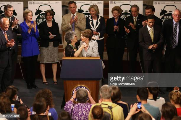 Senate Environment and Public Works Chairwoman Barbara Boxer embraces House Minority Leader Nancy Pelosi join members of the House of Representatives...