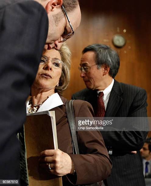 Senate Environment and Public Works Committee Chairwoman Barbara Boxer talks with a staff member as Energy Secretary Steven Chu prepares to testify...