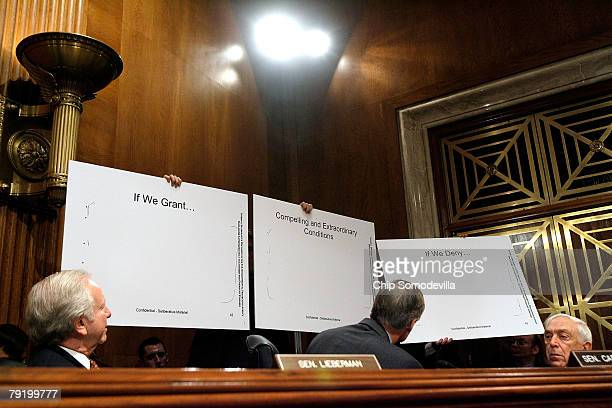 Senate Environment and Public Works Committee hold up examples of redacted documents provided to the committee by the Environmental Protection Agency...