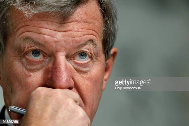 Senate Finance Committee Chairman Max Baucus listens to debate before the committee is set to vote on health care reform legislation on Capitol Hill...