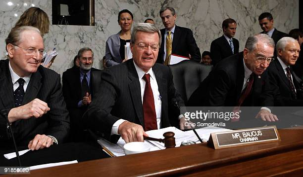 Senate Finance Committee Chairman Max Baucus lowers the gavel after the committee voted 149 to pass health care reform legislation with Sen John...