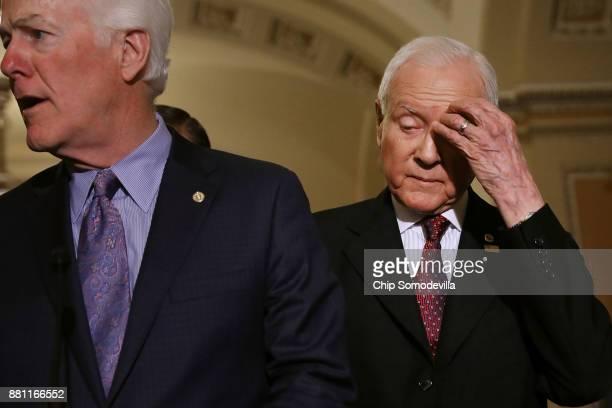 Senate Finance Committee Chairman Orrin Hatch Senate Majority Whip John Cornyn and other GOP senators talk with reporters following the weekly Senate...