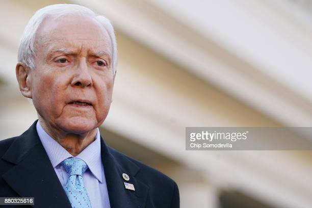 Senate Finance Committee Chairman Orrin Hatch talks with reporters following a lunch meeting with US President Donald Trump at the White House...