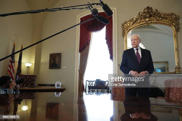 Senate Finance Committee Chairman Orrin Hatch talks with reporters in the Senate President pro tempore office while waiting for the arrival of Judge...