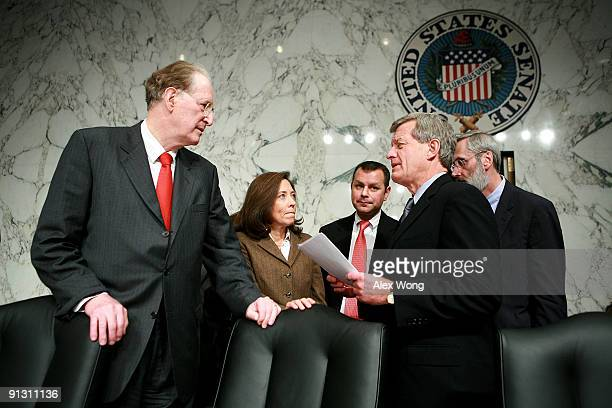 S Senate Finance Committee Chairman Sen Max Baucus talks to Sen John Rockefeller and Sen Maria Cantwell during a break in a hearing on Capitol Hill...