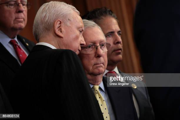 Senate Finance Committee chairman Sen Orrin Hatch whispers to Senate Majority Leader Mitch McConnell during a press event to discuss the GOP plans...