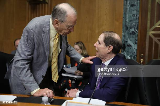 Senate Finance Committee member Sen Charles Grassley talks with committee ranking member Sen Ron Wyden before a hearing with US Secretary of Commerce...
