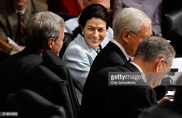 Senate Finance Committee member Sen Olympia Snowe smiles at committee Chairman Max Baucus moments before she announced her support for the health...