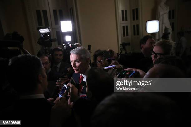 Senate Finance Committee member Sen Rob Portman discusses progress on the tax reform bill with reporters at the US Capitol on December 15 2017 in...
