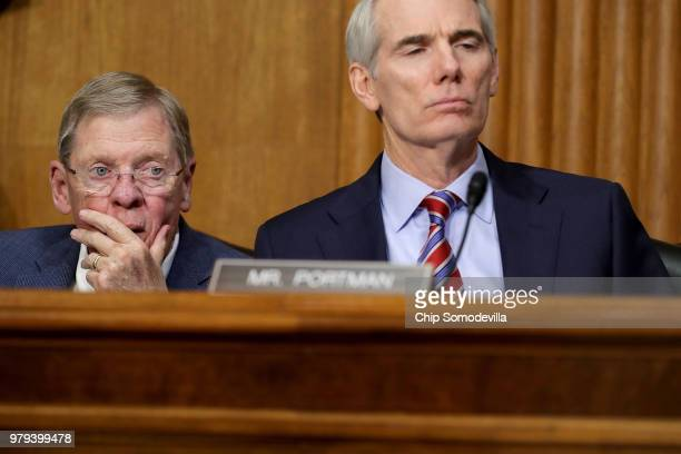 Senate Finance Committee members Sen Johnny Isakson and Sen Rob Portman listen to US Secretary of Commerce Wilbur Ross testifiy before the committee...