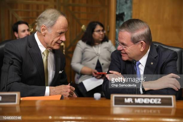 Senate Finance Committee members Sen. Tom Carper and Sen. Robert Menendez talk before New York businessman Andrew Saul's confirmation hearing to be...