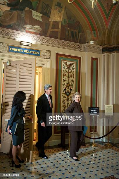 Senate Foreign Relations Chairman John Kerry DMass and Secretary of State Hillary Clinton exit Foreign Relations to start the media availability to...