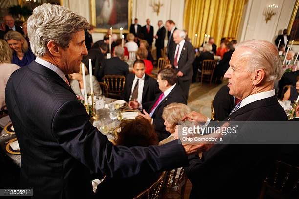 OUT Senate Foreign Relations Committee Chairman John Kerry talks with US Vice President Joe Biden during a dinner with bipartisan Congressional...