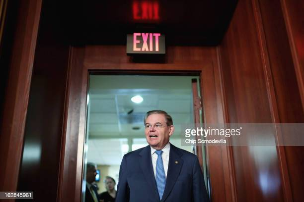 Senate Foreign Relations Committee Chairman Robert Menendez arrives for a news conference at the US Capitol February 28 2013 in Washington DC On the...