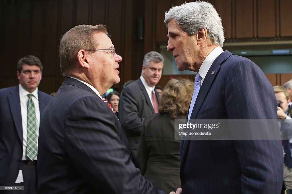 Senate Foreign Relations Committee Chairman Robert Menendez (D-NJ) (L) congratulates Sen. John Kerry (D-MA) after his confirmation hearing to become the next Secretary of State in the Hart Senate Office Building on Capitol Hill January 24, 2013 in Washington, DC. Nominated by President Barack Obama to succeed Hillary Clinton as Secretary of State, Kerry has served on this committee for 28 years and has been chairman for four of those years.