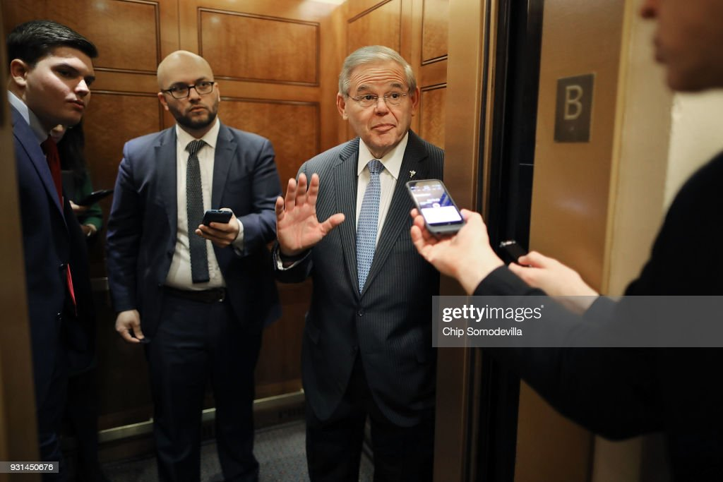 Senate Foreign Relations Committee ranking member Robert Menendez (D-NJ) talks with reporters at the U.S. Capitol March 13, 2018 in Washington, DC. Menendez was asked about President Donald Trump's firing of Secretary of State Rex Tillerson.