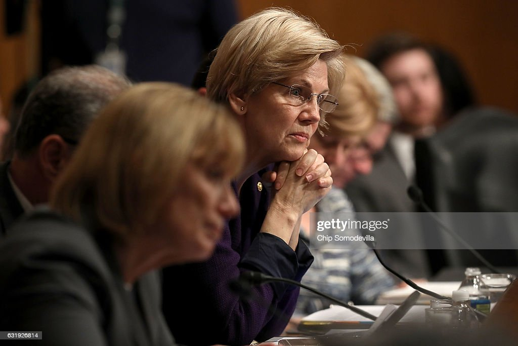 Senate Health, Education, Labor and Pensions Committee member Sen. Elizabeth Warren (D-MA) listens to testimony from Betsy DeVos, President-elect Donald Trump's pick to be the next Secretary of Education, during her confirmation hearing in the Dirksen Senate Office Building on Capitol Hill January 17, 2017 in Washington, DC. DeVos is known for her advocacy of school choice and education voucher programs and is a long-time leader of the Republican Party in Michigan.