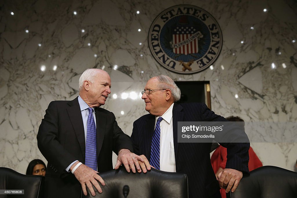 Senate Homeland Security and Governmental Affairs Investigations Subcommittee Chairman Carl Levin (D-MI) (R) and ranking member Sen. John McCain (R-AZ) prepare for a hearing about high speed stock trading in U.s. markets in the Hart Senate Office Building on Capitol Hill June 17, 2014 in Washington, DC. The committee heard testimony from experts and executives about conflicts of interest and the loss of investor confidence due to high speed trading.