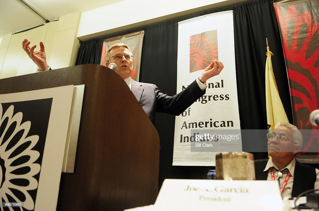 Senate Indian Affairs Committee chairman Byron Dorgan, D-N. Dak., speaks at the National Congress of American Indians' Tribal Nations Legislative Summit in Washington on Monday, March. 3, 2008. NCAI president Joe Garcia is pictured to the right listening to Dorgan's remarks.