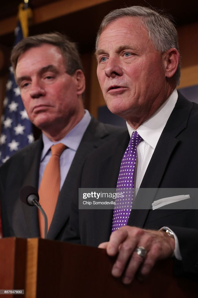 Senate Intelligence Committee Chairman Richard Burr (R-NC) and committee Vice Chair Mark Warner (D-VA) (R) hold a news conference on the status of the committee's inquiry into Russian interference in the 2016 presidential election at the U.S. Capitol October 4, 2017 in Washington, DC. The senators said their investigation is continuing and that they trust the conclusions of the Obama Administration's intelligence community assessment (ICA).