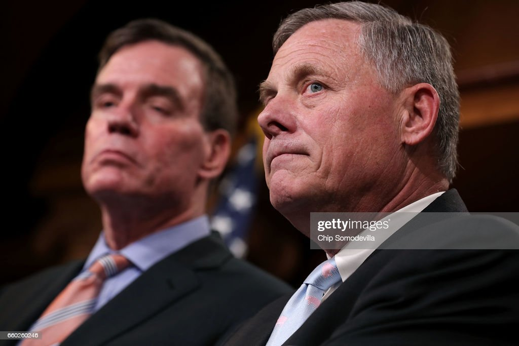Senate Intelligence Committee Chairman Richard Burr (R-NC) (R) and ranking member Sen. Mark Warner (D-VA) hold a news conference about the committee's investigation into Russian interference into the 2016 presidential election at the U.S. Capitol March 29, 2017 in Washington, DC. The senators said that an unprecedented number of committee staff have been given access to information from the intelligence community during this investigation.