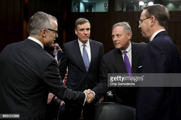 Senate Intelligence Committee Chairman Richard Burr and ranking member Sen Mark Warner greet Acting FBI Director Andrew McCabe and Deputy Attorney...