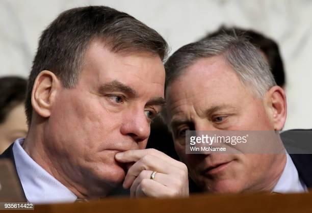 Senate Intelligence Committee Chairman Richard Burr and ranking member Sen Mark Warner confer as Homeland Security Secretary Kirstjen Nielsen and...
