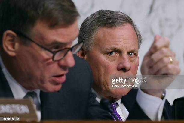Senate Intelligence Committee Chairman Richard Burr listens to ranking member Sen Mark Warner question officials from the intelligence community...