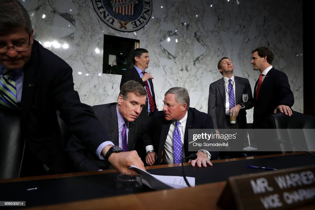 Senate Intelligence Committee Chairman Richard Burr (R-NC) (C) talks with ranking member Sen. Mark Warner (D-VA) (2nd L) at the conclusion of Central Intelligence Agency acting Director Gina Haspel's confirmation hearing to become the next CIA director in the Hart Senate Office Building May 9, 2018 in Washington, DC. If confirmed, Haspel would be the first woman to lead the nation's biggest spy agency. Haspel ran a secret 'black site' CIA prison in Thailand after September 11, 2001, where detainees were subjected to brutal interrogation techniques and she was later involved in approving the destruction of videotapes of interrogation sessions at that prison.