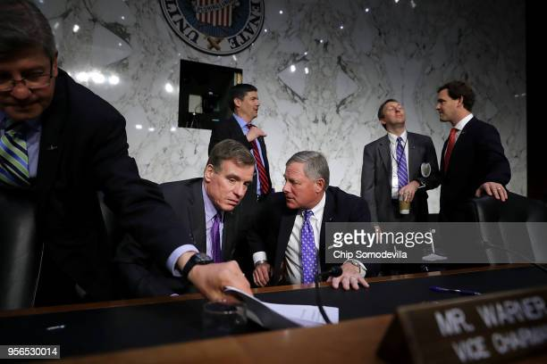 Senate Intelligence Committee Chairman Richard Burr talks with ranking member Sen Mark Warner at the conclusion of Central Intelligence Agency acting...