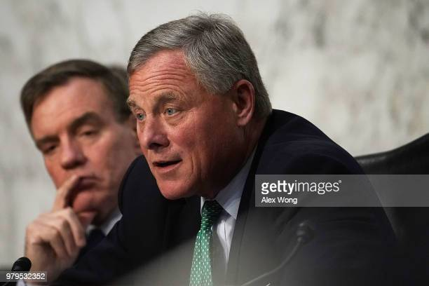 Senate Intelligence Committee Chairman Sen Richard Burr speaks as Vice Chairman Sen Mark Warner listens during a hearing before the committee June 20...