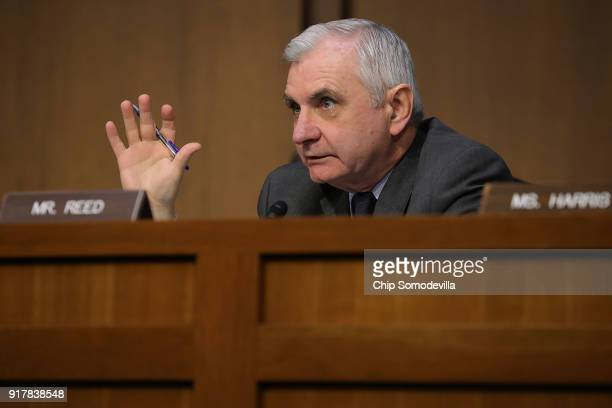 Senate Intelligence Committee member Sen Jack Reed questions intelligence officials including the heads of the FBI CIA and NSA during a hearing in...