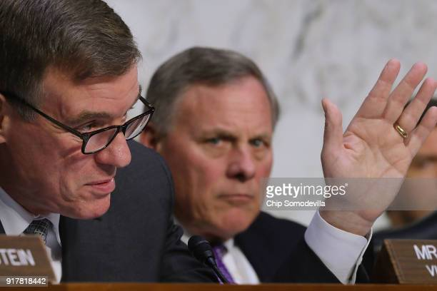 Senate Intelligence Committee ranking member Sen Mark Warner and Chairman Richard Burr question officials from the intelligence community during a...
