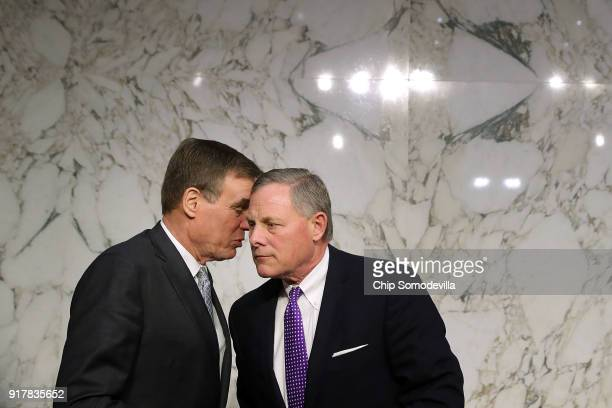 Senate Intelligence Committee ranking member Sen Mark Warner and Chairman Richard Burr confer after hearing testimony from intelligence officials...