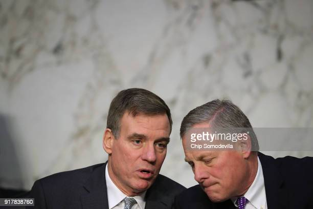 Senate Intelligence Committee ranking member Sen Mark Warner and Chairman Richard Burr confer before hearing testimony from intelligence officials...