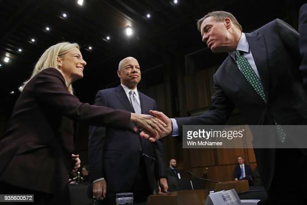 Senate Intelligence Committee ranking member Sen Mark Warner greets Homeland Security Secretary Kirstjen Nielsen and former Homeland Security...