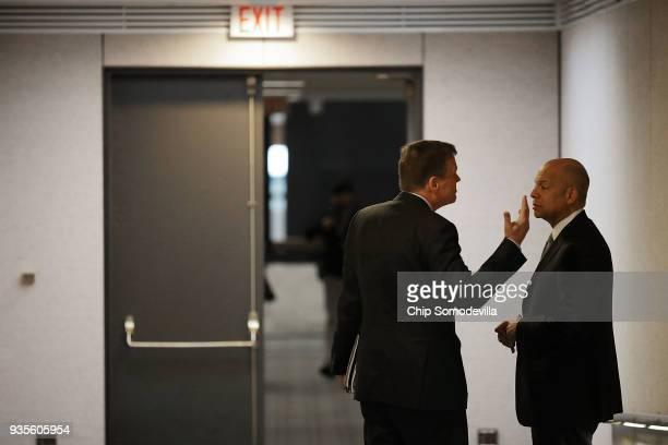 Senate Intelligence Committee ranking member Sen Mark Warner talks with former Homeland Security Secretary Jeh Johnson before he testifies to the...