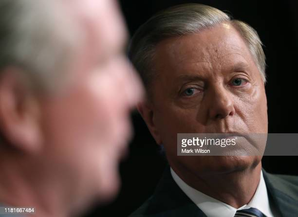 Senate Judiciary Chairman Lindsey Graham, , listens to Sen. Chris Van Hollen, , speak during a news conference to discuss the introduction of...