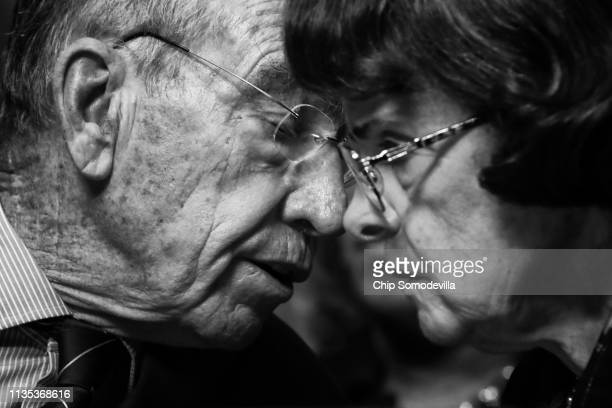 Senate Judiciary Committee Chairman Charles Grassley and raking member Sen. Dianne Feinstein talk during a mark up hearing about Supreme Court...