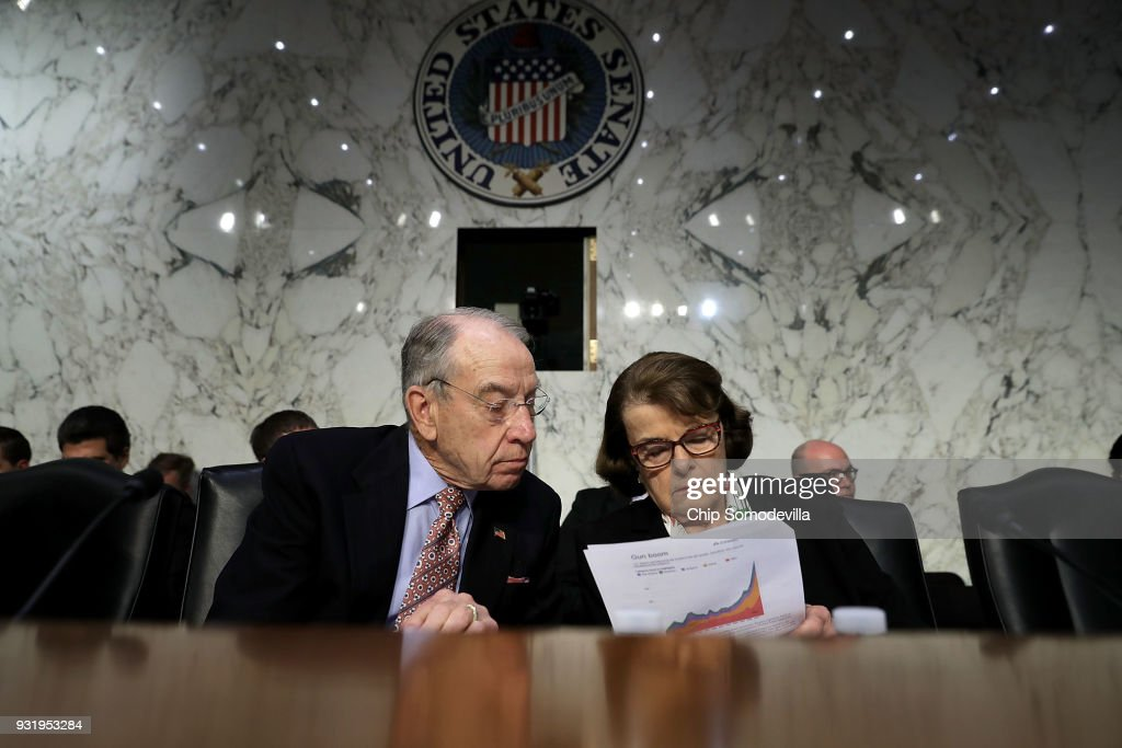 Senate Judiciary Committee Chairman Charles Grassley (R-IA) (L) and ranking member Sen. Dianne Feinstein (D-CA) talk during a hearing about the massacre at Marjory Stoneman Douglas High School in the Hart Senate Office Building on Capitol Hill March 14, 2018 in Washington, DC. Federal Bureau of Investigation acting Deputy Director David Bowdich testified that the FBI could have and should have done more to stop the school shooter Nikolas Cruz after it receieved several tips about him.