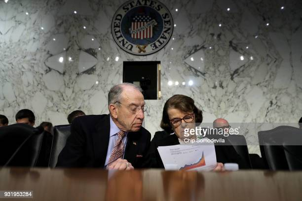 Senate Judiciary Committee Chairman Charles Grassley and ranking member Sen Dianne Feinstein talk during a hearing about the massacre at Marjory...