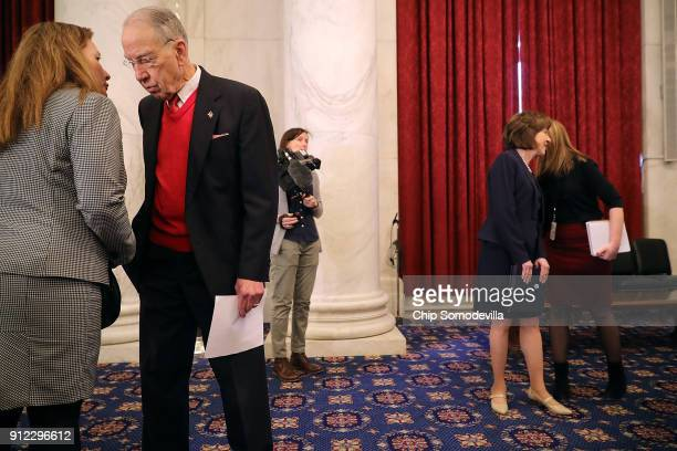 Senate Judiciary Committee Chairman Charles Grassley and Sen Susan Collins hear from staff members before a news conference with former gymnasts to...